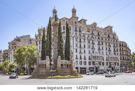 BARCELONA SPAIN - JULY 5 2016: Verdaguer square in Barcelona Spain. Named after the Catalan-language epic poet of the Jacint Verdaguer (1845-1902). Monument built in 1912