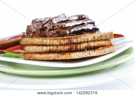 served notched meat with eggplant on white