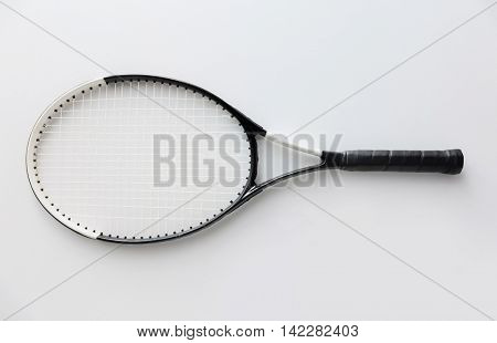 sport, fitness, healthy lifestyle and objects concept - tennis racket