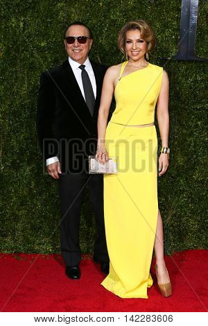 NEW YORK-JUN 7: Tommy Mottola (L) and Thalia attend American Theatre Wing's 69th Annual Tony Awards at Radio City Music Hall on June 7, 2015 in New York City.