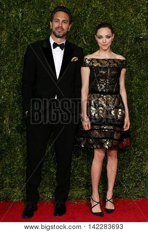 NEW YORK-JUN 7: Actors Thomas Sadoski (L) and Amanda Seyfried attend American Theatre Wing's 69th Annual Tony Awards at Radio City Music Hall on June 7, 2015 in New York City.