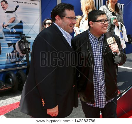 NEW YORK-APR 11: Director Andy Fickman (L) and actor Rico Rodriguez attend the world premiere of