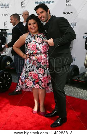 NEW YORK-APR 11: Actors Raini Rodriguez (L) and Eduardo Verastegui attend the world premiere of