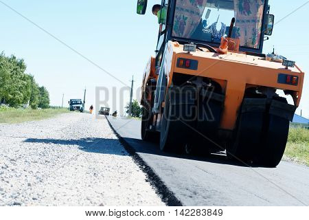 HALBSTADT, RUSSIAN FEDERATION - AUGUST 8, 2016: Asphalt Roller paving new road in the countryside