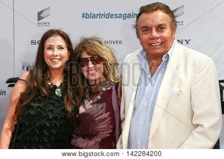 NEW YORK-APR 11: Actor Shelly Desai (R) and family attend the world premiere of