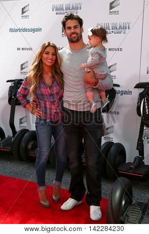 NEW YORK-APR 11: (L-R) Jessie James Decker, NFL player Eric Decker and Vivianne Decker attend the premiere of