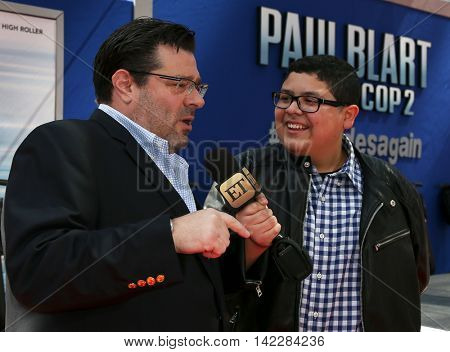 NEW YORK-APR 11: Rico Rodriguez (R) interviews director Andy Fickman for Entertainment Tonight (ET) at the