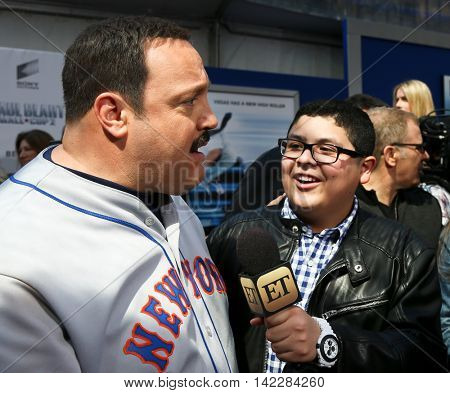 NEW YORK-APR 11: Kevin James is interviewed by Rico Rodriguez for Entertainment Tonight (ET) at the premiere of