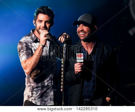 NEW YORK-SEPT 28: Singer Thomas Rhett (L) and radio host Cody Alan at the iHeartRadio Album Release Party with Thomas Rhett on September 28, 2015 at the iHeartRadio Theater in New York City.