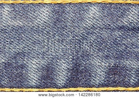 Denim jeans texture with strings and seams for fashion background