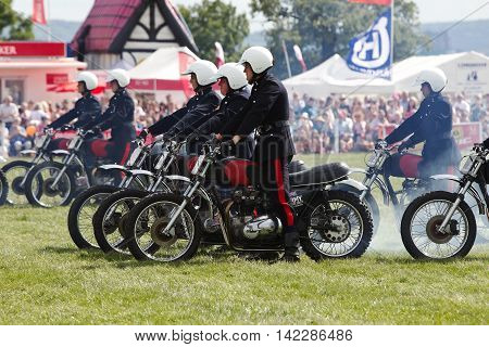 WEEDON, UK - AUGUST 29: Riders of the Royal Signals White Helmets display team demonstrate formation riding on motorcycles for the public at the Bucks County show on August 29, 2013 in Weedon