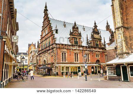 Haarlem, Netherlands - April 2, 2016: Picturesque beautiful traditional house of De Hallen Museum, people in Haarlem, Holland