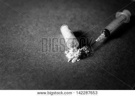 Images of drug needles and drug. The picture is staged and there is no real drugs. (ฺBlack and white Image)