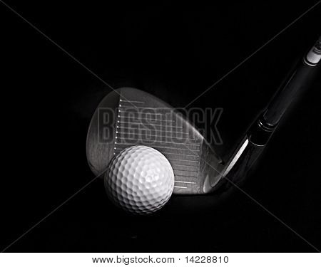 Golf Club hitting Golf Ball