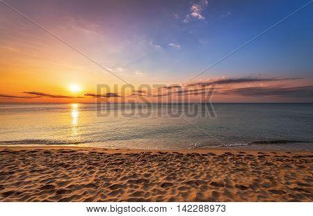 Beatiful sunrise on the tropical beach. Golden sands.