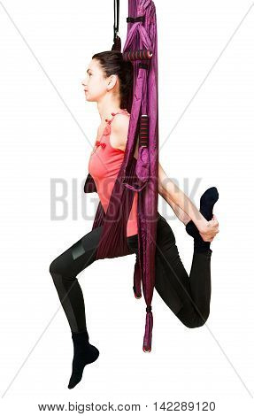 Woman making aerial yoga exercises fly yoga isolated on white background
