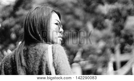 Portait of Asian woman looking to the right with blur bokeh background high key