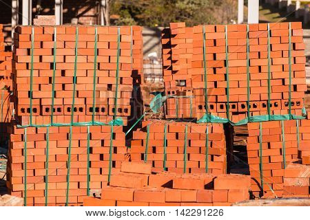 Bricks building construction materials stacked on pallets.