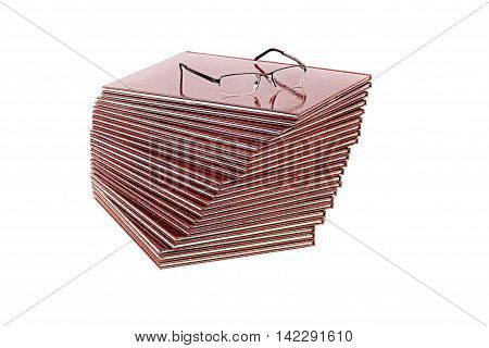 Books and glasses on a white background