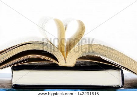 Heart inside a book on a white background
