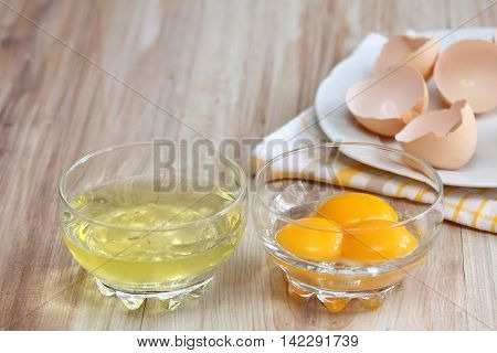 How to separate egg- white and yolks into two bowls and egg shells are at background
