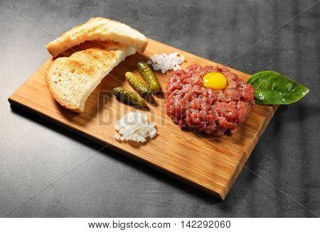 Tartare on cutting board