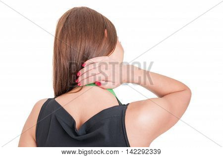 Rear View Of Young Employee With Neck Pain