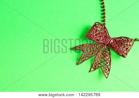 Red bow isolated on a green background