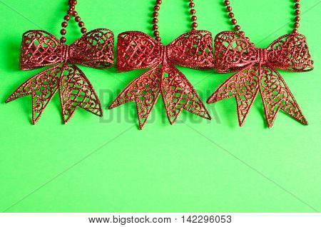 Red bows isolated on a green background