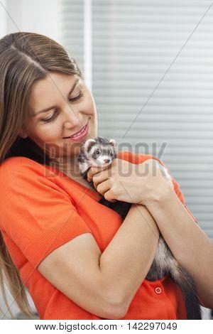 Happy Woman Embracing Weasel