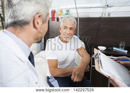 Senior Patient Looking At Doctor In Rehab Center