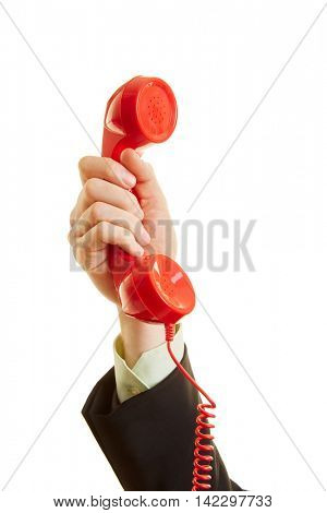 The hand of a man holding a red telephone in the air