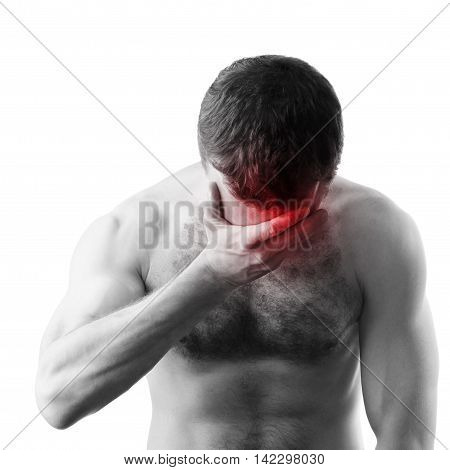 Young adult shirtless sporty man with headache isolated on white background. Black and white stylized photo with red local ache spot