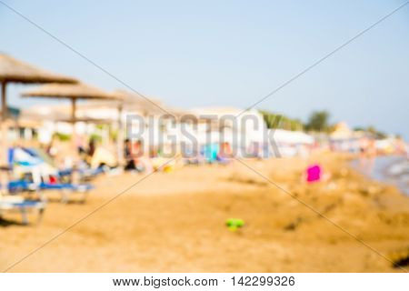 CORFU, GREECE - JULY 28, 2016:   Sandy beach of Corfu, Blurred image