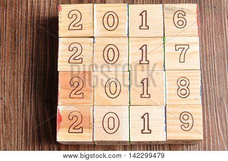 2016 2017 2018 2019 written with wooden blocks on wooden