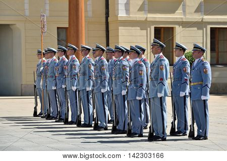PRAGUE CZECH REPUBLIC - AUGUST 08 2016: Changing of the Guards ceremony on August 08 2016 in Prague. It takes place in Prague Castle at 12.00 daily and attracts many tourists and citizens.