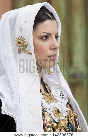 CAGLIARI, ITALY - May 1, 2014: 358 ^ Religious Procession of Sant'Efisio - Sardinia - portrait of a beautiful girl in traditional Sardinian costume