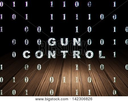 Safety concept: Glowing text Gun Control in grunge dark room with Wooden Floor, black background with Binary Code