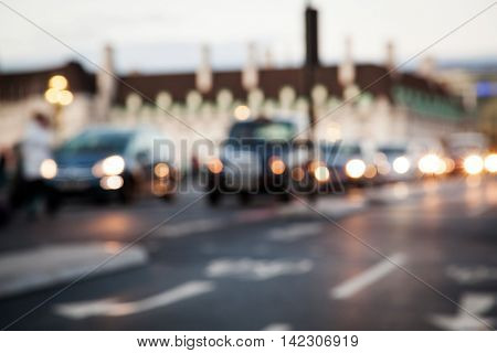 Rush hour with defocused cars and generic vehicles - Blurred bokeh postcard of iconic city of London - Real life transportation concept