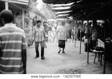 Prachuapkhirikhan Thailand -april 24 2016: Unidentified people at thai traditional market Prachuapkhirikhan Province Thailand / high contrast black and white picture style Grain added