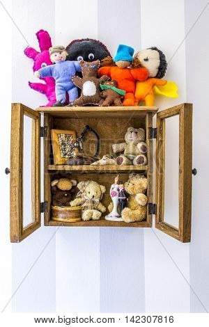 Old rustic wood wall mounted display cabinet, items, stuffed toys and memories.