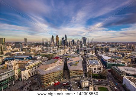 Wide angle skyline view of east London with the famous financial Bank district and beautiful clouds - London, UK