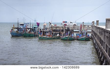 Prachuapkhirikhan THAILAND - june 07 2016 - Unidentified fishing boat laying at a local port to trade many fish into a car in Prachuapkhirikhan province Thailand on June 07 2016