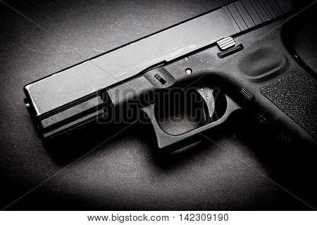 a polymer  hand gun on black background