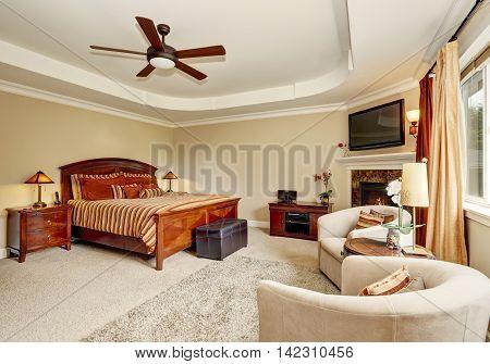 Master Bedroom Interior With Corner Fireplace