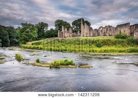 Finchale Priory and River Wear, as it flows past the medieval ruin, in County Durham