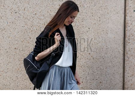 Lovely brunette student girl with backpack, portrait outdoors