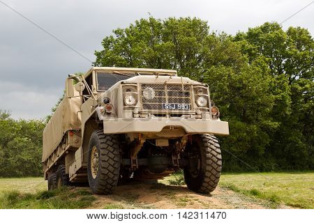 DENMEAD, UK - MAY 24: An ex US army GS service truck goes through its paces in the arena obstacle course for the public to watch at the Overlord show on May 24, 2015 in Denmead.