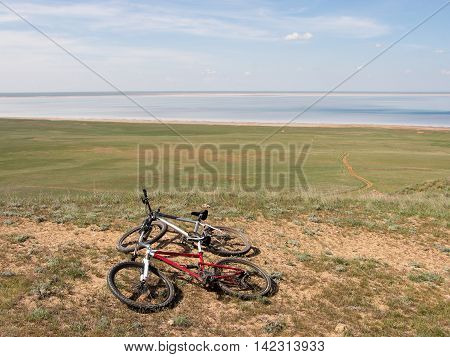 Two road bicycle on the road near mount Big Bogdo and solt lake Baskunchak