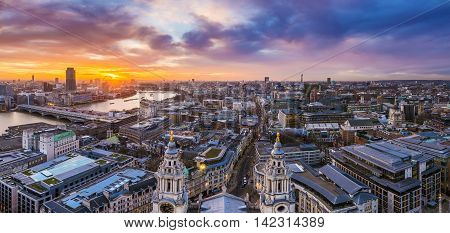 Panoramic skyline and Beautiful sunset over central London with famous landmarks, shot from top of St.Paul's Cathedral - England, UK